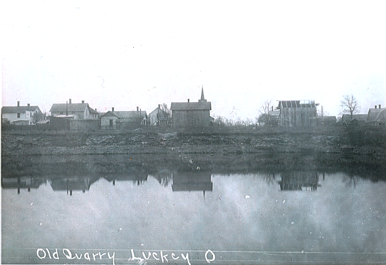 Luckey Quarry 1909 north of main street looking south, Lutheran Church steeple in view